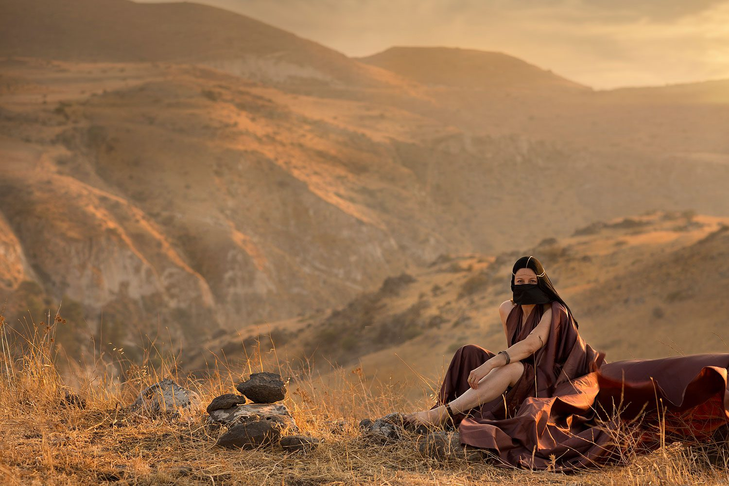 "Tamar, Judah's daughter-in-law ""And she put off from her the garments of her widowhood, and covered herself with her veil, and wrapped herself, and sat in the entrance of Enaim, which is by the way to Timnah; .. When Judah saw her, he thought her to be a harlot; for she had covered her face."" Genesis 38 15-15"